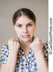 aggressive young woman showing her fist