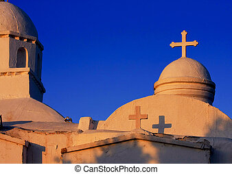 Aghios Georgios Church at sunset on Lycabettus Hill in Athens against a blue sky