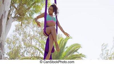 Agile supple gymnast performing an acrobatic dance - Agile...