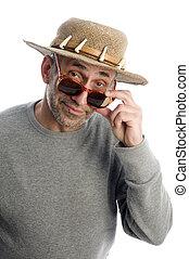 aging artist thinking  suglasses adventure hat