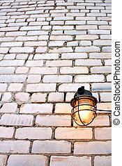aging lamp on brick wall