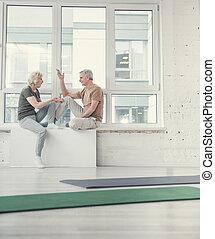 Aging people having vivid conversation