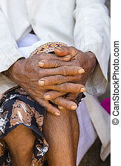 Aging process - very old senior man hands wrinkled skin....