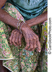 Aging process - very old senior woman hands wrinkled skin,...
