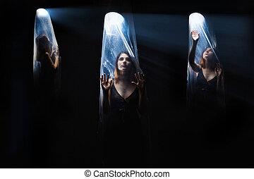 agoraphobia 3 girls woman inside a plastic bag, bright light...