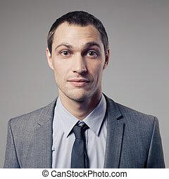agradável, homem negócios, retrato, ligado, cinzento, fundo