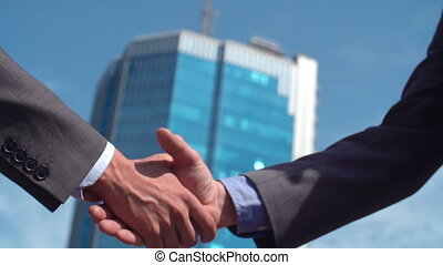 Agreement Gesture - Low angle of two cropped businessmen...