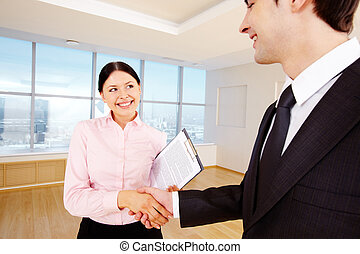 Agreement - Photo of happy partners handshaking after...