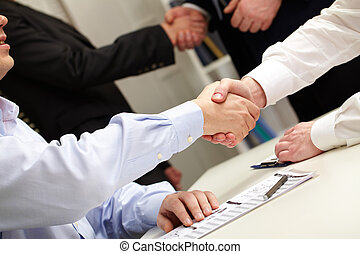 Agreement - Business people shaking hands after successful...