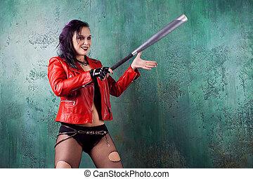 agresivo, punk, mujer, huelga, alguien, con, un, murciélago, en, rojo, chaqueta de cuero
