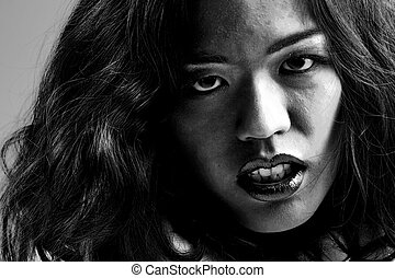 Agressive chinese girl - Young chinese girl on a dark...