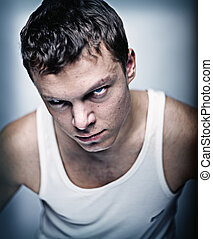 agressive  man  - aggressive view young man portrait