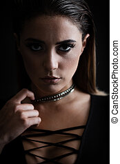 Agressive woman in bodysuit - Closeup portrait of a young...