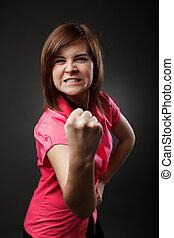 agressivo, senhora jovem, mostrando, punho