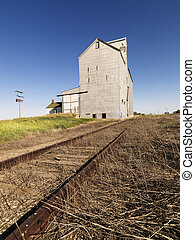 Agricultural building. - Grain Elevator and railroad tracks.