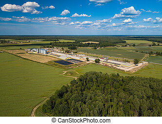 Agricultural , factory aerial view. Green field.