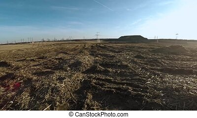 Agricultural field and power lines 26 - Agricultural field...
