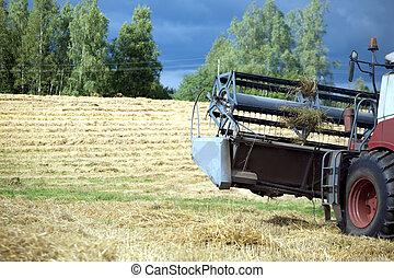 agricultural harvester on field