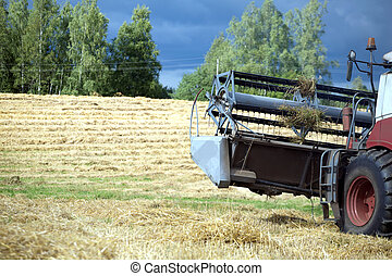 agricultural harvester on field