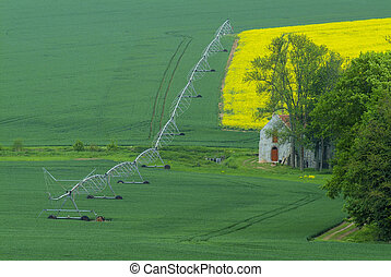 Agricultural irrigation system watering field