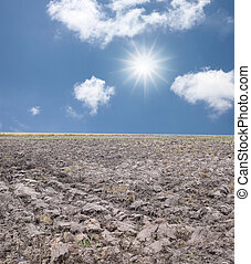 Agricultural land in rural areas and blue sky. - ...
