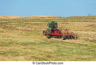 the tractor working in a field
