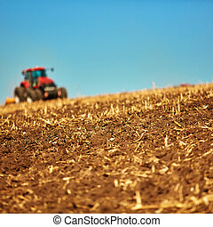 Agricultural Landscape. Tractor working on the field.