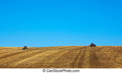 Agricultural Landscape. Tractors working on the field.