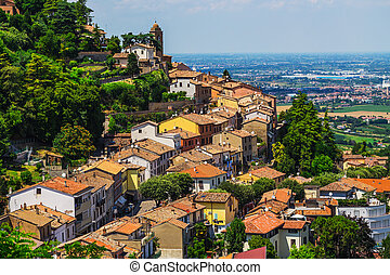 agricultural landscape with old village in toscana (italy)