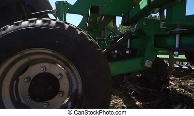 Agricultural Machinery. Close up of Tractor Sowing and...