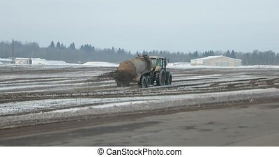 agricultural machinery fertilizes fields in winter.
