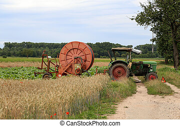 Agricultural machinery in the fields for irrigation of plantations