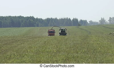 Agricultural machinery mulchers and harvesters as they work...