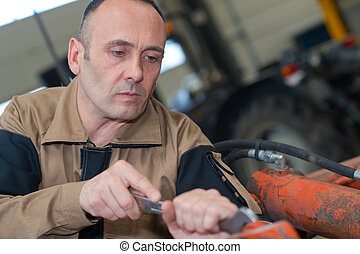 Agricultural mechanic at work