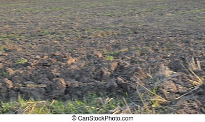 agricultural plowed field - closeup turn view of...