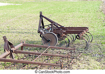 agricultural tools - farm tools lying on the ground