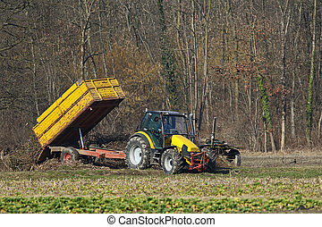 Agricultural tractor at work