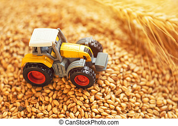 Agricultural tractor toy and harvested wheat