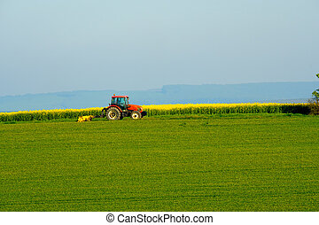 Agricultural tractor working in a countryside