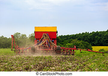 agricultural work plowing land on a powerful tractor
