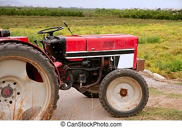 Agriculture aged red tractor  retro vintage machine
