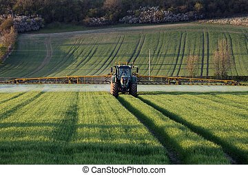Agriculture - Farmer Spraying Crops - Agriculture - A farmer...