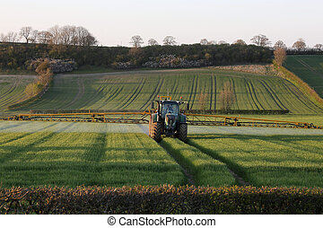 Agriculture - Farmer Spraying Crops