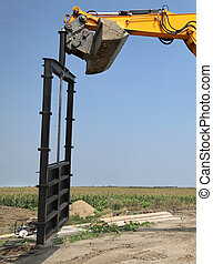 Agriculture, irrigation gate at channel construction site