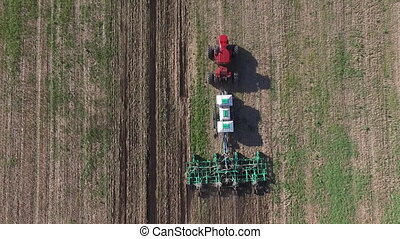 Agriculture machine plow fields dron view