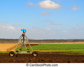 Agriculture Ploughed field with irrigation equipment -...