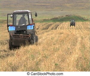 The Tractor plows the land.