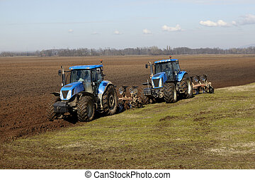 tractor working on cultivated land cultivation