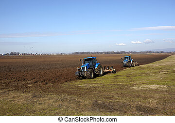 agriculture tractor cultivated land field vegetable -...