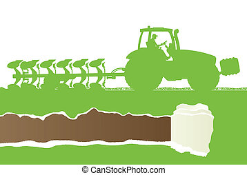 Agriculture tractor plowing the land in cultivated country ...